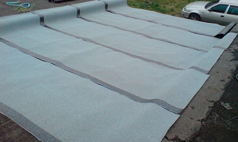 Чем и как правильно покрыть крышу гаража своими руками